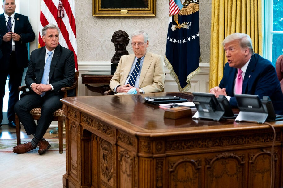WASHINGTON, DC - JULY 20: U.S. President Donald Trump (R) talks to reporters while hosting House Minority Leader Kevin McCarthy (R-CA) (2nd L), Senate Majority Leader Mitch McConnell (R-KY) and members of Trump's cabinet in the Oval Office at the White House July 20, 2020 in Washington, DC. Trump and the congressional leaders talked about a proposed new round of financial stimulus to help the economy during the ongoing global coronavirus pandemic.  (Photo by Doug Mills/Getty Images)