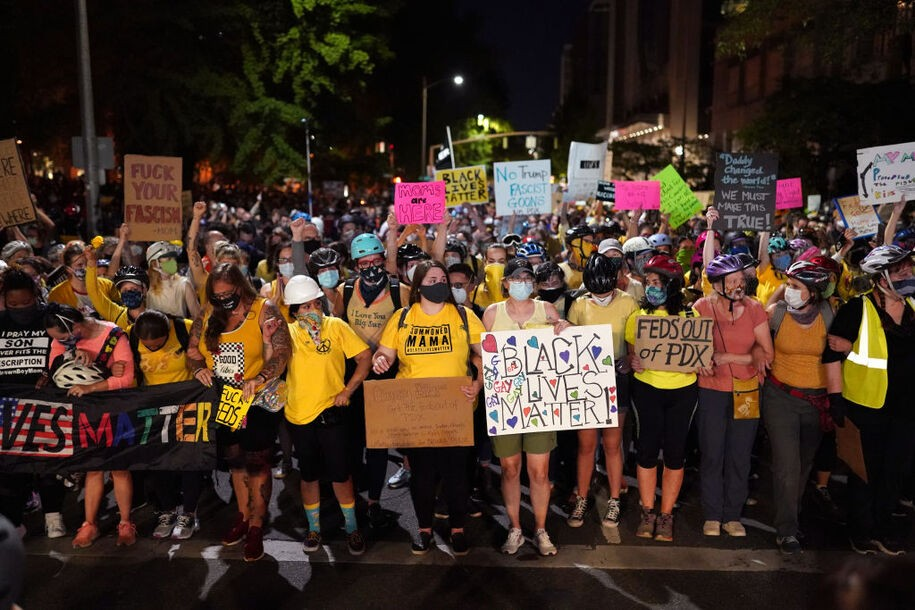 PORTLAND, OR - JULY 20: Mothers form the front line of a protest march toward Mark O. Hatfield U.S. Courthouse on July 20, 2020 in Portland, Ore. Monday night marked 54 days of protests in Portland following the death of George Floyd in police custody. (Photo by Nathan Howard/Getty Images)