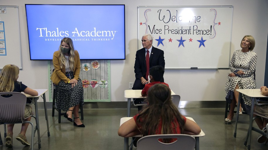 Mike Pence and Betsy DeVos visit elementary school and take off masks to talk to 4th graders