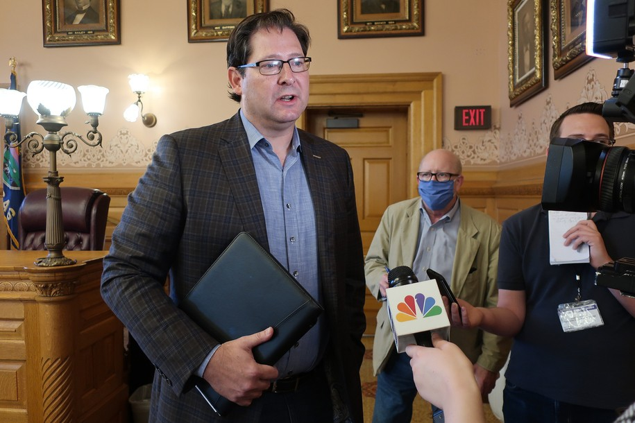 After COVID hospitalization, Kansas Republican did not disclose before meeting with governor