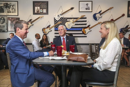 Georgia Gov. Brian Kemp, left, eats lunch with Vice President Pence, center, and Georgia first lady Marty Kemp, right, at the Star Cafe in Atlanta, Friday, May 22, 2020, during the coronavirus pandemic. (John SpinkAtlanta Journal-Constitution via AP)