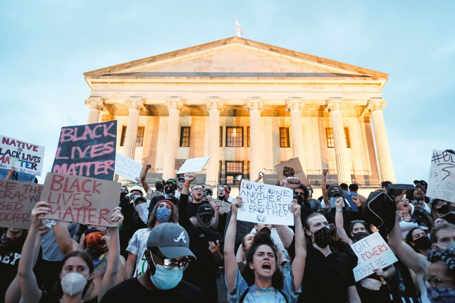 NASHVILLE, TENNESSEE - JUNE 04: Protesters are seen marching upon the Tennessee State Capitol building on June 04, 2020 in Nashville, Tennessee.  Minneapolis Police officer Derek Chauvin was filmed kneeling on George Floyd's neck. Floyd was later pronounced dead at a local hospital. Across the country, Floyd's death has set off days and nights of protests as its the most recent in a series of deaths of African Americans by the police.  (Photo by Jason Kempin/Getty Images)