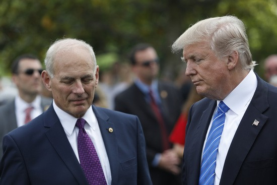 ARLINGTON, VA - MAY 29: President Donald Trump stands with Secretary of Homeland Security John Kelly after laying flowers on the grave of Kelly's son, First Lieutenant Robert Kelly, at Arlington National Cemetery on May 29, 2017 in Arlington, Virginia. Lt. Kelly was killed in 2010 while leading a patrol in Afghanistan. (Photo by Aaron P. Bernstein/Getty Images)