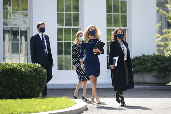 WASHINGTON, DC - OCTOBER 02: White House Press Secretary Kayleigh McEnany exits the West Wing on her way to do a television interview outside of the White House on October 2, 2020 in Washington, DC.   President Donald Trump and First Lady Melania Trump have both tested positive for coronavirus. (Photo by Drew Angerer/Getty Images)