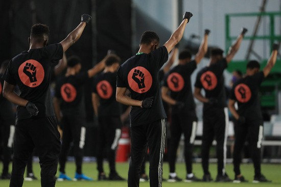 REUNION, FLORIDA - JULY 08: Players of MLS teams participate in a  Black Lives Matter pre-game ceremony before match between Orlando City and Inter Miami as part of MLS is back Tournament at ESPN Wide World of Sports Complex on July 08, 2020 in Reunion, Florida. (Photo by Mike Ehrmann/Getty Images)