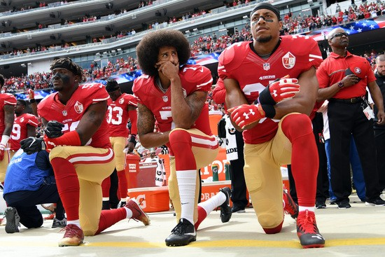SANTA CLARA, CA - OCTOBER 02:   (L-R) Eli Harold #58, Colin Kaepernick #7 and Eric Reid #35 of the San Francisco 49ers kneel on the sideline during the anthem prior to the game against the Dallas Cowboys at Levi's Stadium on October 2, 2016 in Santa Clara, California. (Photo by Thearon W. Henderson/Getty Images)