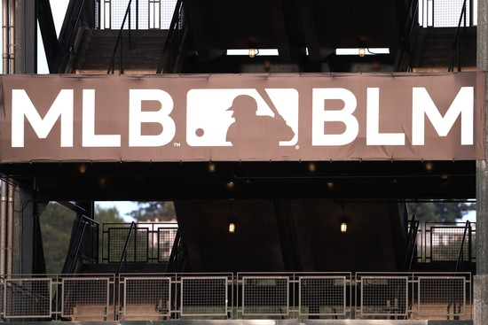 SEATTLE, WASHINGTON - JULY 31: A general view of signage from the MLB to support the Black Lives Matter movement during an Opening Day game between the Seattle Mariners and Oakland Athletics at T-Mobile Park on July 31, 2020 in Seattle, Washington. (Photo by Abbie Parr/Getty Images)