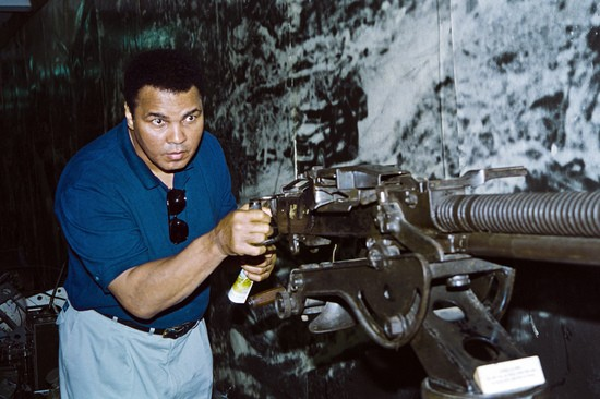 Former heavyweight World boxing champion Muhammad Ali tries a 12,7mm anti-aircraft gun used by North Vietnamese army during the Vietnam war and which is now on display at Hanoi Army Museum in Hanoi, Vietnam on May 12, 1994. Ali, once convicted for refusing to serve in the US military during the Vietnam War, arrived on May 10, for a five-day goodwill visit aimed at helping resolve the MIA issue.        (Photo credit should read HOANG DINH NAM/AFP via Getty Images)