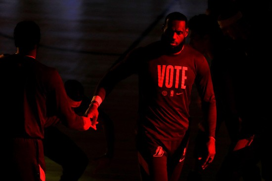 LAKE BUENA VISTA, FLORIDA - OCTOBER 11: LeBron James #23 of the Los Angeles Lakers walks onto the court prior to the start of the game against the Miami Heat in Game Six of the 2020 NBA Finals at AdventHealth Arena at the ESPN Wide World Of Sports Complex on October 11, 2020 in Lake Buena Vista, Florida. NOTE TO USER: User expressly acknowledges and agrees that, by downloading and or using this photograph, User is consenting to the terms and conditions of the Getty Images License Agreement.  (Photo by Mike Ehrmann/Getty Images)