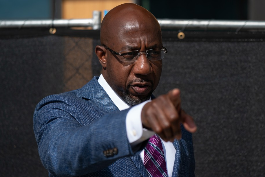 ATLANTA, GA - OCTOBER 21: Democratic U.S. senatorial candidate Raphael Warnock gestures to a staffer after casting his ballot at State Farm Arena on October 21, 2020 in Atlanta, Georgia. Warnock is hoping to unseat incumbent Kelly Loeffler. (Photo by Elijah Nouvelage/Getty Images)