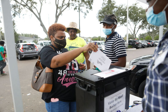 TAMPA, FL - NOVEMBER 01: Felicia Bottom cast her mail-in voting ballot at the C. Blythe Andrews, Jr. Public Library during the NAACP Hillsborough County Branch Souls to the Polls voter drive on November 1, 2020 in Tampa, Florida. The Souls to the Polls event is geared to push for a stronger African-American turnout. (Photo by Octavio Jones/Getty Images)