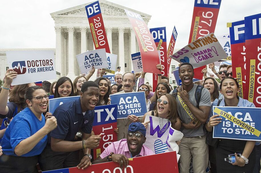 """Supporters rally in front of the Supreme Court after the court's announcment of the decision affirming the Affordable Care Act on  June 25, 2015, in Washington, DC. US President Barack Obama on Thursday hailed the Supreme Court's decision to uphold his legacy-gilding health care law, casting the ruling as a victory for Americans, not just him. """"Today is a victory for hard-working Americans all across this country, whose lives will continue to become more secure in a changing economy because of this law,"""" he said, in a White House address. AFP PHOTO/PAUL J. RICHARDS        (Photo credit should read PAUL J. RICHARDS/AFP via Getty Images)"""