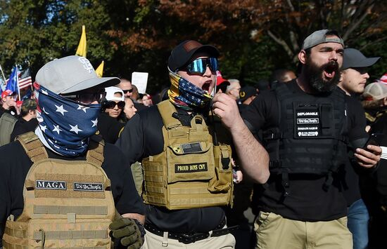 """Members of """"The Proud Boys"""" join supporters of US President Donald Trump during a rally in Washington, DC, on November 14, 2020. - Supporters are backing Trump's claim that the November 3 election was fraudulent. (Photo by Olivier DOULIERY / AFP) (Photo by OLIVIER DOULIERY/AFP via Getty Images)"""