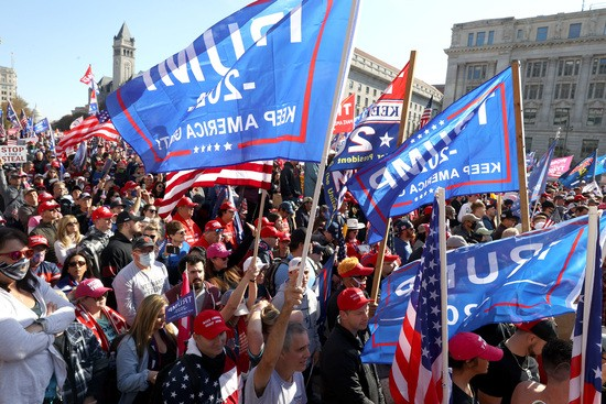 """WASHINGTON, DC - NOVEMBER 14: People participate in the """"Million MAGA March†from Freedom Plaza to the Supreme Court, on November 14, 2020 in Washington, DC. Supporters of U.S. President Donald Trump marching to protest the outcome of the 2020 presidential election. (Photo by Tasos Katopodis/Getty Images)"""