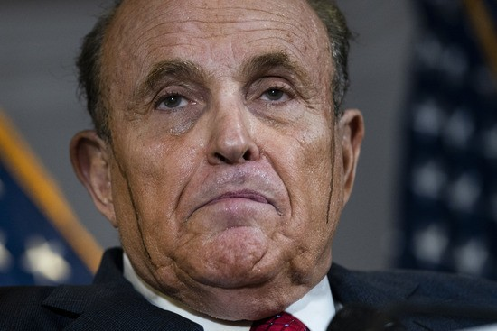 WASHINGTON, DC - NOVEMBER 19: Rudy Giuliani speaks to the press about various lawsuits related to the 2020 election, inside the Republican National Committee headquarters on November 19, 2020 in Washington, DC. President Donald Trump, who has not been seen publicly in several days, continues to push baseless claims about election fraud and dispute the results of the 2020 United States presidential election. (Photo by Drew Angerer/Getty Images)