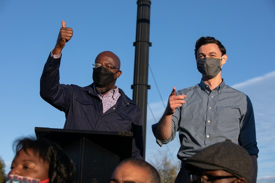 MARIETTA, GA - NOVEMBER 15: Democratic U.S. Senate candidates Jon Ossoff (R) and Raphael Warnock (L) of Georgia hold a rally on November 15, 2020 in Marietta, Georgia. Ossoff and Warnock face incumbent U.S. Sens. David Purdue (R-GA) and Kelly Loeffler (R-GA) respectively in a January 5 runoff election. (Photo by Jessica McGowan/Getty Images)