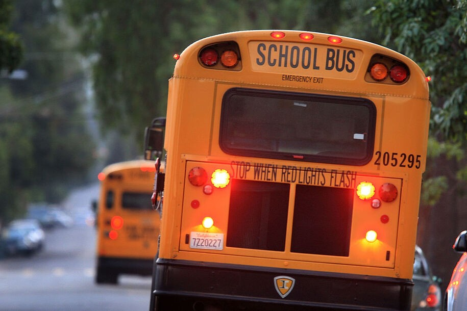 PASADENA, CA - OCTOBER 10:  School buses drive down teh road to pick up children before classes begin on October 10, 2008 in Pasadena, California. California State Treasurer Bill Lockyer has warned that California cash revenues will run out by the end of the month. If that happens, 5,000 California cities, counties, and school districts will face job layoffs and payments for law enforcement agencies, nursing homes, teachers, and other services and government entities could be suspended. A worldwide credit crunch threatens to derail state plans for a routine 7 billion dollar loan to even out the tax flow into the state treasury. Just two weeks after state lawmakers came to agreement, after months of haggling on a record-overdue state budget, California Gov. Arnold Schwarzenegger is warning of future cuts to the state budget to deal with skyrocketing financial problems. A frozen credit market and revenues for the first quarter of the fiscal year that fell more than a billion dollars short of previous projections are causing the governor and state legislative leaders scrabbling to deal with a new budget mess.    (Photo by David McNew/Getty Images)