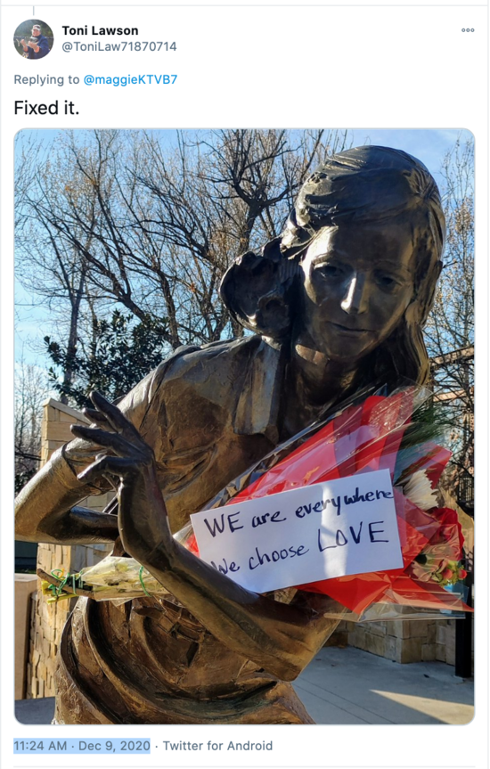 "Screenshot of tweet in support of Anne Frank Memorial in Boise Idaho following  Nazi vandalism. Flowers and a sign reading ""WE are everywhere. We choose LOVE."""