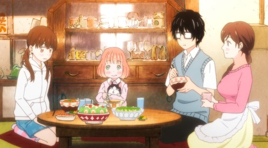 Kirigama Rei has dinner with a family that has taken him in the anime series March Comes in Like a Lion