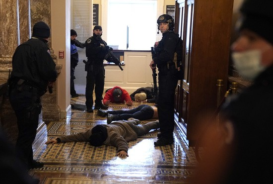 WASHINGTON, DC - JANUARY 06: U.S. Capitol Police stand detain protesters outside of the House Chamber during a joint session of Congress on January 06, 2021 in Washington, DC. Congress held a joint session today to ratify President-elect Joe Biden's 306-232 Electoral College win over President Donald Trump. A group of Republican senators said they would reject the Electoral College votes of several states unless Congress appointed a commission to audit the election results. (Photo by Drew Angerer/Getty Images)