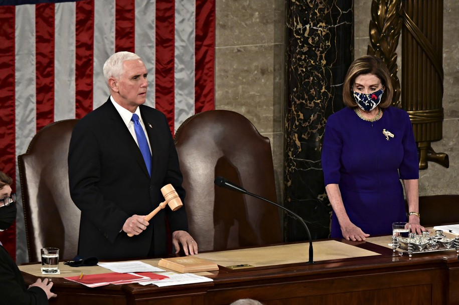 WASHINGTON, DC - JANUARY 06: Speaker of the House Nancy Pelosi (D-CA), center right, listens as Vice President Mike Pence speaks during a joint session of Congress to count the Electoral College votes of the 2020 presidential election in the House Chamber on January 6, 2021 in Washington, DC. Congress is meeting to certify Joe Biden as the winner of the 2020 presidential election, with scores of Republican lawmakers preparing to challenge the tally in a number of states during what is normally a largely ceremonial event. (Photo by Erin Scott - Pool/Getty Images)