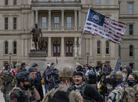 LANSING, MI - OCTOBER 17: The Boogaloo Boys hold a rally at the Capitol Building on October 17, 2020 in Lansing, Michigan. The Boogaloo boys called it a Unity Rally in an attempt to distance themselves from the Wolverine Watchmen who plotted to kidnap Michigans Governor Gretchen Whitmer. Two of the men arrested in the plot were affiliated with the Boogaloo Boys. (Photo by Seth Herald/Getty Images)