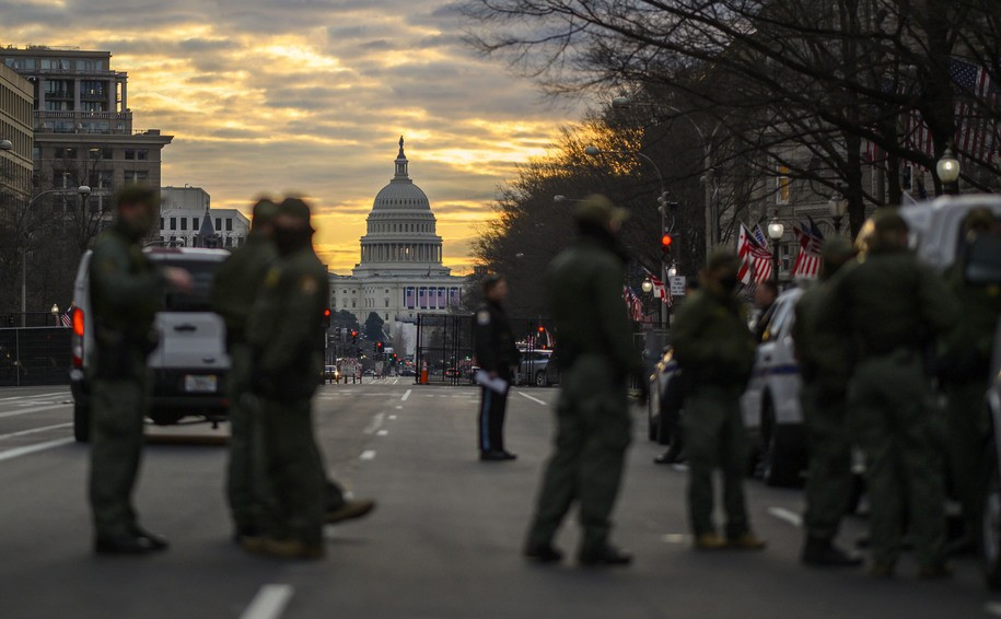 Pennsylvania Avenue with the Capitol in the background is seen under heavy security in the early hours of January 18, 2021 ahead of Joe Biden's swearing-in inauguration ceremony as the 46th US president in Washington, DC on January 20th. - With war-zone-like security, no crowds and coronavirus distancing for guests, Joe Biden's swearing-in as the 46th US president will be a muted affair unlike any previous inauguration. Where Washington is normally packed with hundreds of thousands of supporters, celebrities, socialites and lobbyists, the US capital is eerily quiet ahead of Biden's big day, which promises to be a mostly televised celebration of democracy. (Photo by Eric BARADAT / AFP) (Photo by ERIC BARADAT/AFP via Getty Images)