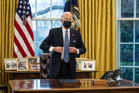 WASHINGTON, DC - JANUARY 25: U.S. President Joe Biden stands after signing an executive order in the Oval Office of the White House on January 25, 2021 in Washington, DC. President Biden signed an executive order repealing the ban on transgender people serving openly in the military. (Photo by Doug Mills-Pool/Getty Images)