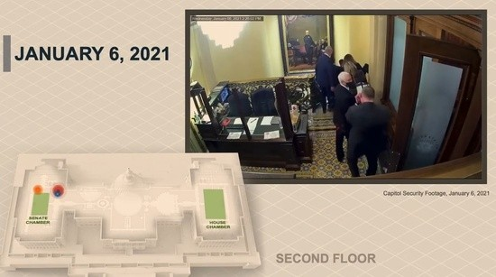 Pence is led away, with insurgents just a few feet down a hallway.