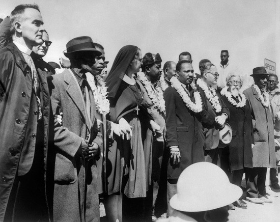 "Civil rights demonstrators, led by Dr Martin Luther King (5th R), civil rights activist Ralph Abernathy (5th L), John Lewis (3rd L) and other civil and religious leaders, make their way from Selma to Montgomery on March 22, 1965 in Alabama, on the third leg of the Selma to Montgomery marches. The Selma-to-Montgomery March for voting rights ended three weeks and represented the political and emotional peak of the modern civil rights movement. The first march took place on March 07, 1965 (""Bloody Sunday"") when 600 civil rights marchers were attacked by state and local police. (Photo credit should read -/AFP via Getty Images)"