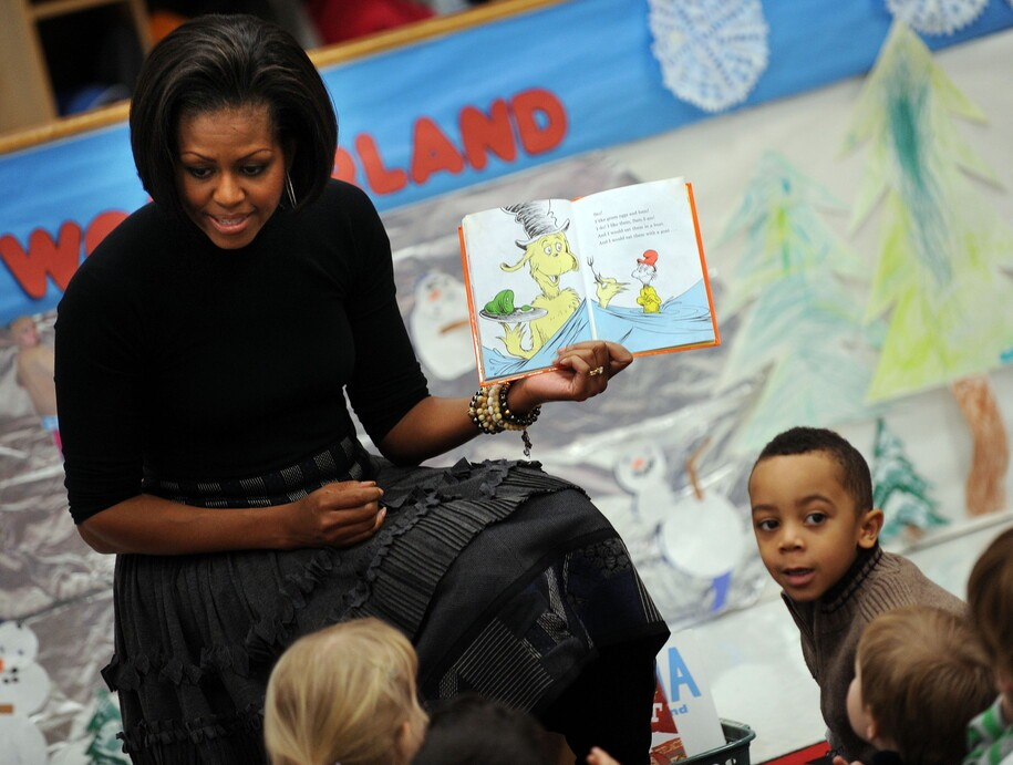 "US First Lady Michelle Obama reads the classic Dr. Seuss book ""Green Eggs and Ham"" to children at the US Department of Labor Day Care Center on January 14, 2010 in Washington, DC.  AFP PHOTO / Tim Sloan (Photo credit should read TIM SLOAN/AFP via Getty Images)"