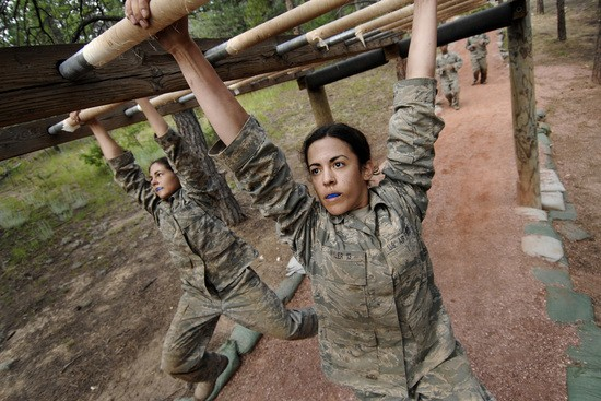 Air Force Academy basic cadets attack the monkey bars July 21 at the Jacks Valley Assault Course near Colorado Springs, Colo. The fall academic semester begins Aug. 6.  (U.S. Air Force photo/Dennis Rogers)