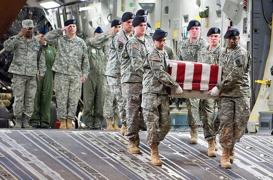 Dignified transfer: United States Army soldiers unload the remains of Specialist Israel Candelaria Mejias, killed in combat operations in Iraq