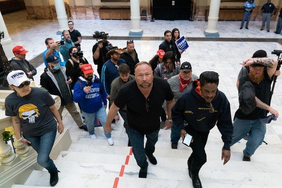 """ATLANTA, GA - NOVEMBER 18: Alex Jones, host of Infowars, an extreme right-wing program that often trafficks in conspiracy theories, is seen inside the Georgia State Capitol during a """"Stop the Steal"""" rally against the results of the U.S. Presidential election on November 18, 2020 in Atlanta, Georgia. (Photo by Elijah Nouvelage/Getty Images)"""
