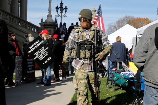 """People gather at the Michigan State Capitol for a """"Stop the Steal"""" rally in support of US President Donald Trump on November 14, 2020, in Lansing, Michigan. - Supporters are backing Trump's claim that the November 3 election was fraudulent. (Photo by JEFF KOWALSKY / AFP) (Photo by JEFF KOWALSKY/AFP via Getty Images)"""
