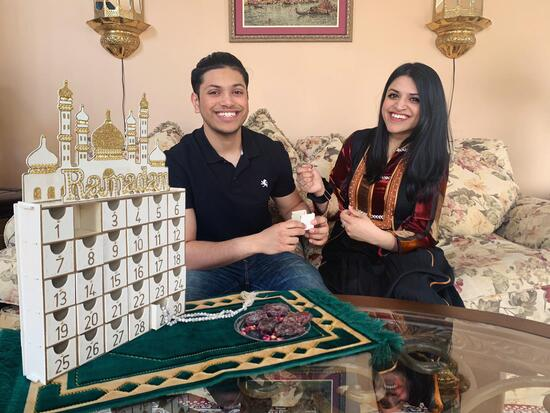 Aysha Qamar and her brother exchange gifts for one another as a Ramadan tradition