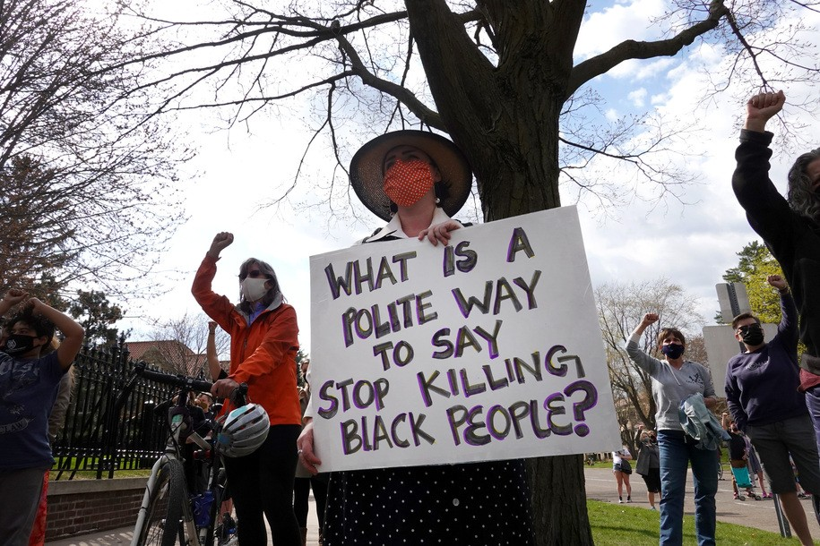 ST PAUL, MINNESOTA - APRIL 18: Demonstrators gather outside the governor's mansion for a rally and march against police brutality on April 18, 2021 in St. Paul, Minnesota. The Minneapolis area is making preparations for a verdict in the trial of Derek Chauvin, the former Minneapolis police officer facing murder charges in the death of George Floyd, which is expected later in the week.  There have also been several days of protests in the area after the recent shooting of 20-year-old Daunte Wright by a suburban Brooklyn Center police officer.   (Photo by Scott Olson/Getty Images)