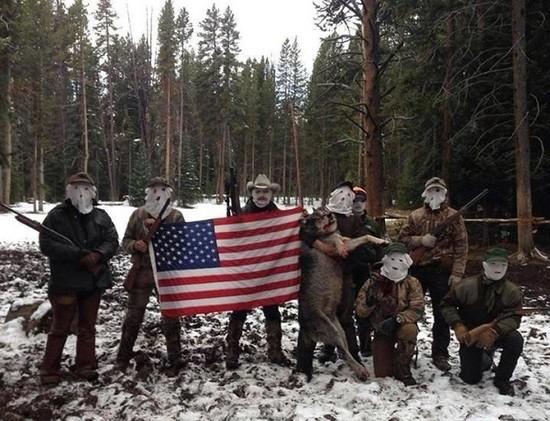 Militiamen with dead wolf