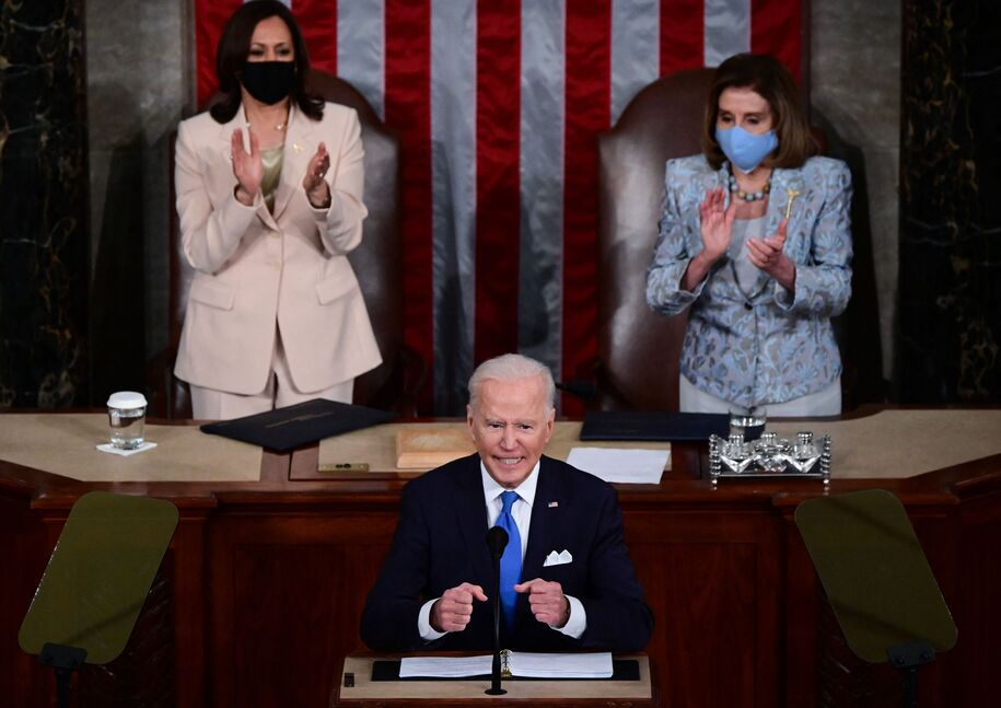 US President Joe Biden addresses a joint session of Congress as US Vice President Kamala Harris and US Speaker of the House Nancy Pelosi listen at the US Capitol in Washington, DC, on April 28, 2021. (Photo by JIM WATSON / POOL / AFP) (Photo by JIM WATSON/POOL/AFP via Getty Images)