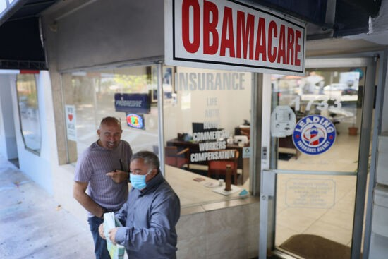MIAMI, FLORIDA - JANUARY 28: An Obamacare sign is seen outside of the Leading Insurance Agency, which offers plans under the Affordable Care Act (also known as Obamacare) on January 28, 2021 in Miami, Florida. President Joe Biden signed an executive order to reopen the Affordable Care Act's federal insurance marketplaces from February 15 to May 15. (Photo by Joe Raedle/Getty Images)