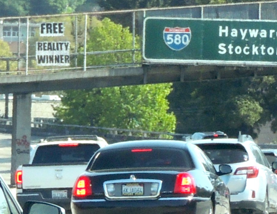 free reality winner sign over I-580