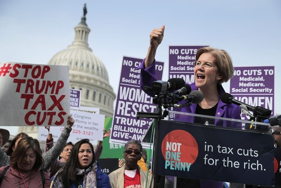 WASHINGTON, DC - NOVEMBER 01:  Sen. Elizabeth Warren (D-MA) addresses a rally against the Republican tax plan outside the U.S. Capitol November 1, 2017 in Washington, DC. The rally was organized by Patriotic Millionaires, left-wing group of weathy people who support political representation for all citizens and believe that the rich should shoulder a greater burden of taxes.  (Photo by Chip Somodevilla/Getty Images)