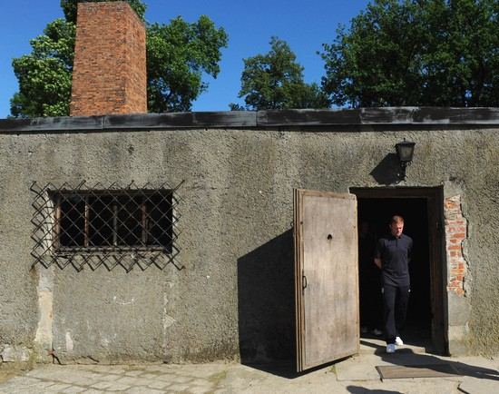 OSWIECIM, POLAND - JUNE 08:   Wayne Rooney leaves the gas chamber and crematoria during a visit by an England Football Association delegation to the Auschwitz-Birkenau memorial and former concentration camp, ahead of UEFA Euro 2012, on June 8, 2012 in Oswiecim, Poland.  (Photo by Michael Regan - Pool/Getty Images)