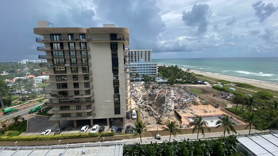 The wreckage of a partially collapsed building in Surfside north of Miami Beach, Florida on June 25, 2021. - Four people are now known to have died in the collapse of an oceanfront apartment building near Miami Beach, officials said Friday, while the number of unaccounted for has risen to 159 -- fueling fears of a much higher death toll. (Photo by Gianrigo MARLETTA / AFP) (Photo by GIANRIGO MARLETTA/AFP via Getty Images)