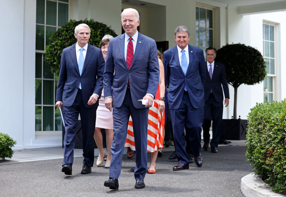 WASHINGTON, DC - JUNE 24: President Joe Biden, joined by a group of bipartisan Senators, walks to deliver remarks after the group of Senators reached a deal on an infrastructure package at the White House on June 24, 2021 in Washington, DC. Biden said both sides made compromises on the nearly $1 trillion infrastructure bill. (Photo by Kevin Dietsch/Getty Images)