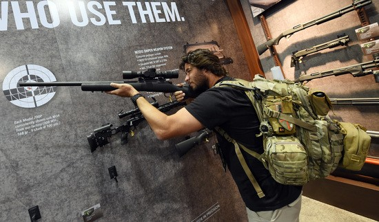 LAS VEGAS, NV - JANUARY 19:  Billy Harris tries out a .308 caliber rifle at the Remington booth at the 2016 National Shooting Sports Foundation's Shooting, Hunting, Outdoor Trade (SHOT) Show at the Sands Expo and Convention Center on January 19, 2016 in Las Vegas, Nevada. The SHOT Show, the world's largest annual trade show for shooting, hunting and law enforcement professionals, runs through January 23 and is expected to feature 1,600 exhibitors showing off their latest products and services to more than 62,000 attendees.  (Photo by Ethan Miller/Getty Images)