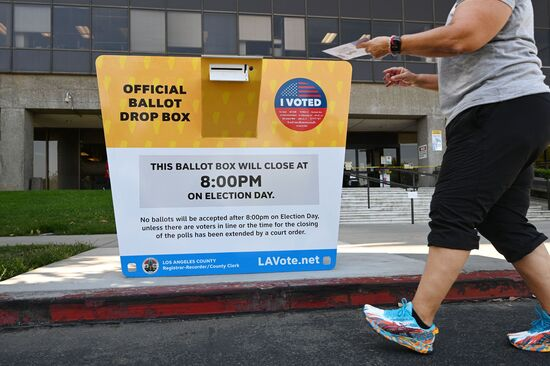A person drops off their California gubernatorial recall election ballot into a ballot box outside the Los Angeles County Registrar-Recorder/County Clerk office, August 27, 2021 in Norwalk, California. - The recall election, which will be held on September 14, 2021, asks voters to respond two questions: whether Newsom, a Democrat, should be recalled from the office of governor, and who should succeed Newsom if he is recalled. Forty-six candidates, including nine Democrats and 24 Republicans, are looking to take Newsom's place as the governmental leader of California. (Photo by Robyn Beck / AFP) (Photo by ROBYN BECK/AFP via Getty Images)