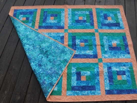 Baby quilt, traditional log cabin pattern.