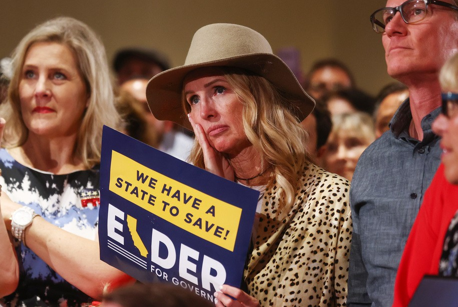 COSTA MESA, CALIFORNIA - SEPTEMBER 14: Supporters watch as gubernatorial recall candidate Larry Elder speaks at an election night event on September 14, 2021 in Costa Mesa, California. Californians headed to the polls today to cast their ballots in the California recall election of Gov. Gavin Newsom.  (Photo by Mario Tama/Getty Images)