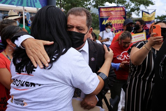 WASHINGTON, DC - SEPTEMBER 21: Rep. Jesus 'Chuy' Garcia (D-IL) embraces a supporter during rally in support of a pathway to citizenship for the more than 11 million undocumented immigrants living in the United States on September 21, 2021 in Washington, DC. Activists, union leaders, organizers and political leaders addressed the marchers as they rallied outside the headquarters of the U.S. Immigration and Customs Enforcement and the U.S. Capitol. (Photo by Chip Somodevilla/Getty Images)